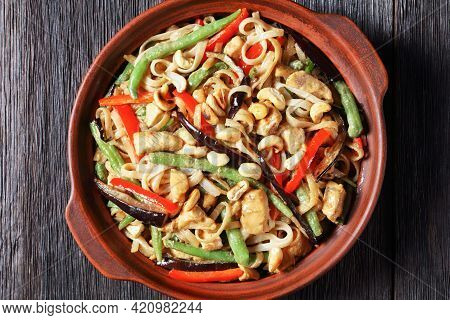 Chicken Satay Rice Noodle With Green Beans, Pepper And Eggplant In A Bowl On A Wooden Table, Horizon