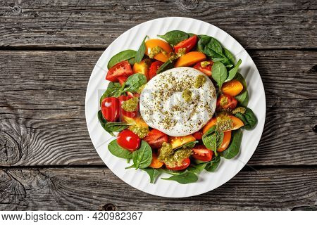 Spinach, Tomato And Burrata Cheese Salad With Basil Pesto Dressing On A Plate, Flat Lay, Free Space,
