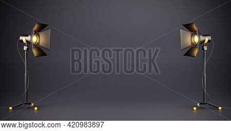 Dark TV studio with spotlights on stands for a movie and tv show filming on a dark background. Professional Studio lighting equipment for the production of cinema. Empty space. 3d illustration.