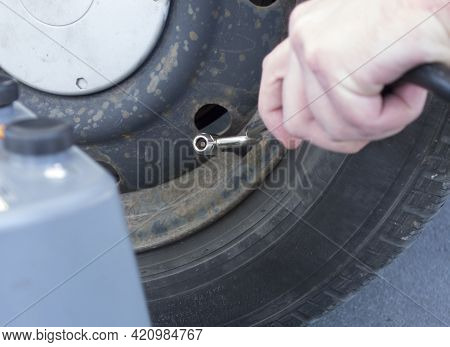 Checking The Tire Pressure Of A Car