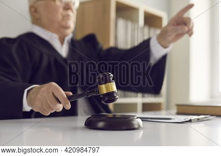 Hammer Blow Made By A Mature Judge Passing Sentence And Announcing The Closure Of The Case.