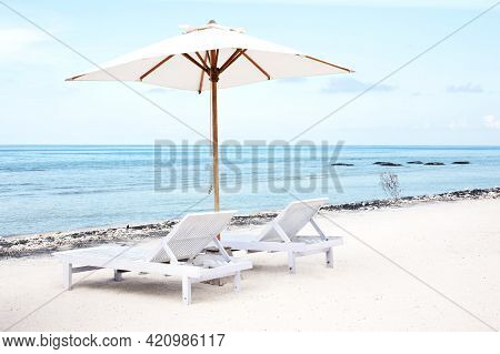 Beach Chairs And Parasol On Exotic Tropical White Sandy