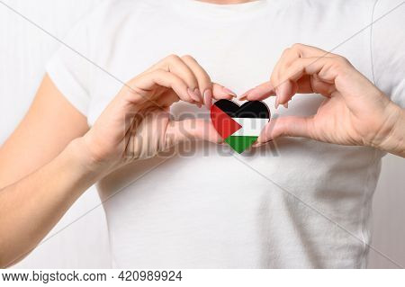 Flag Of Palestine In The Shape Of A Heart In The Hands Of A Girl. Love Palestine. The Concept Of Res