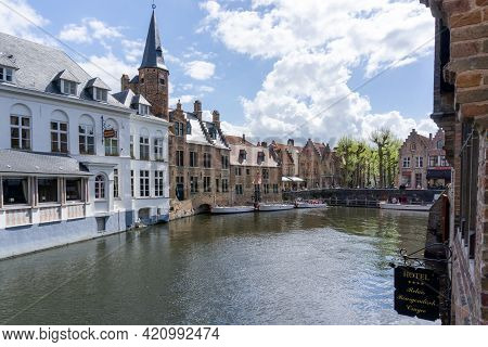 View Of The Historic City Center And Canals In Downtown Bruges