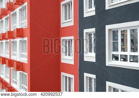 Facade Of A Multi-storey Apartment Building, Exterior Close-up. Multi-colored Wall Decoration And Pl