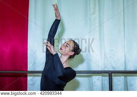 Pretty Young Woman In Dancing Studio, Woman Exercising In Dance Studio, Young Woman Is Dancing