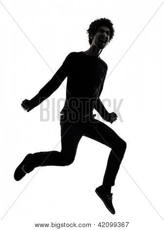 one african handsome young man jumping screaming  in silhouette studio isolated on white background