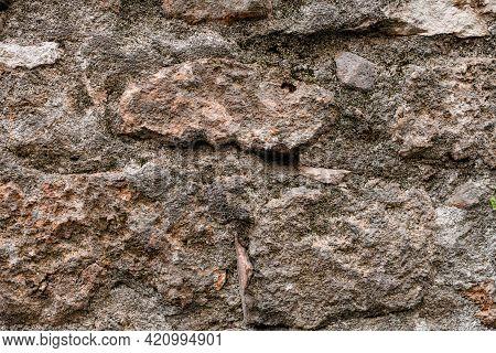Close-up Of Grey Granite Stone Masonry At Wall. Texture Of Natural Granite Stones.