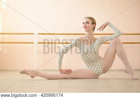 Graceful Hyper-flexible Ballerina Is Training In A Dance Class With Ballet Machines.