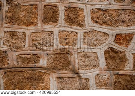 Fragment Of Stone Wall With Shell Rock Masonry. Natural Stone Texture Background.