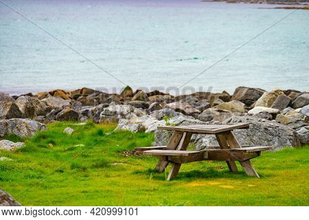 Picnic Site Rest Stop Area Wooden Table And Benches On Norwegian Lake Fjord Shore. Holidays Relaxati