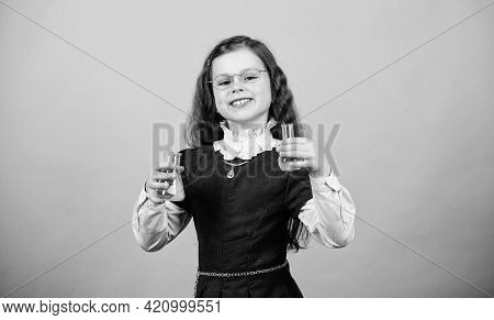Small Girl Scientist With Testing Flask. Back To School. Education And Knowledge. Child Study Bilogy