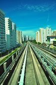 Perspective view of railway track surrounded by apartments at Punggol - Singapore poster
