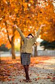 vertical photo happy beautiful little girl joyful laughter throw up autumnal leafage in park poster