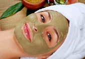 Spa Mud Mask. Woman in Spa Salon. Face Mask. Facial Clay Mask. Treatment poster