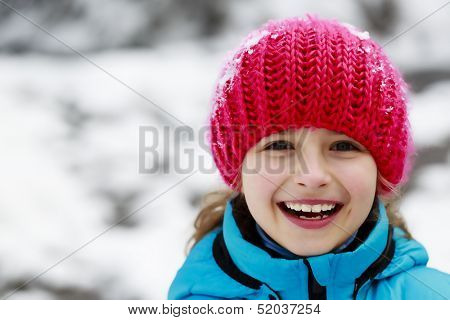 Winter, snow, winter fun - lovely girl enjoying winter