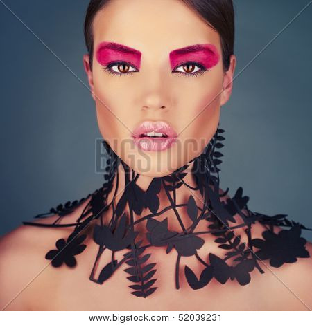 Beautiful young lady with a delicate floral pattern on neck. High-fashion collar