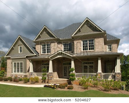 Luxury Model Home Exterior Stormy Weather