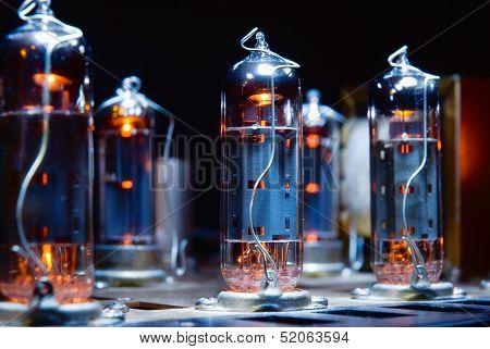 Glowing vacuum electron tubes of vintage guitar amplifier poster