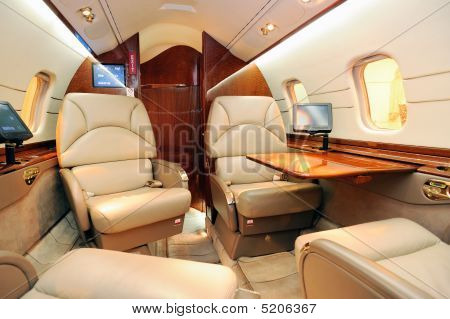 Interior of a luxurious jet airplane . poster