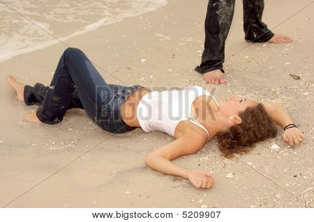 Beautiful Sexy Young Woman In Wet Jeans At Beach