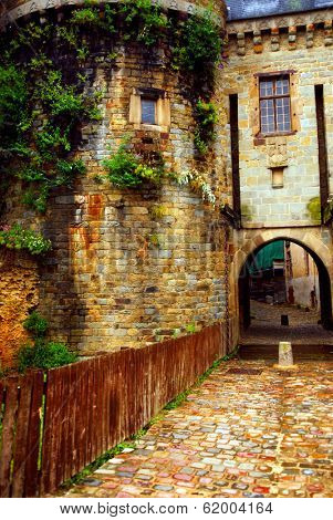 Medieval stone wall and tower in Rennes, France.