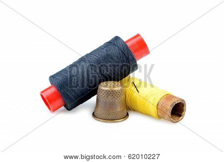Old Thimble And Needle With Thread Isolated