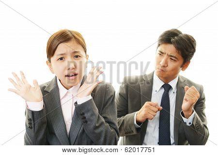 Dissatisfied businessman and businesswomen