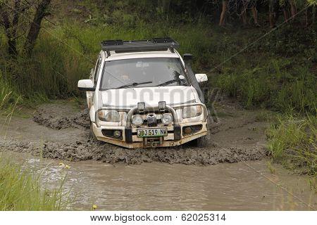 White Mazda Bt-50 4X4 3L Crossing Muddy Pond