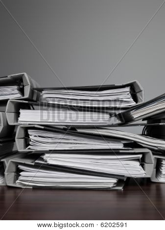 Files Stacked On A Desk