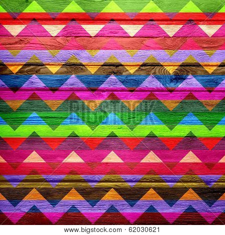 Colorful chevron pattern on wood texture background