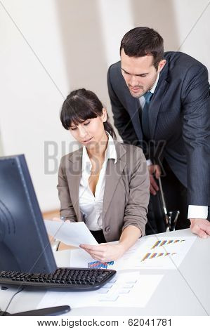 Manager Overseeing Business Woman