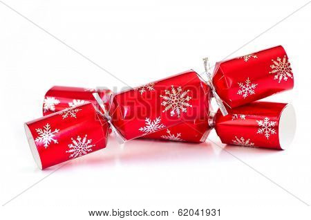Two red Christmas crackers isolated on white