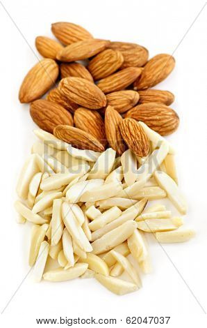 Whole and slivered raw almonds in a pile on white background