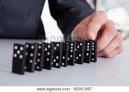 Businessman Playing Domino