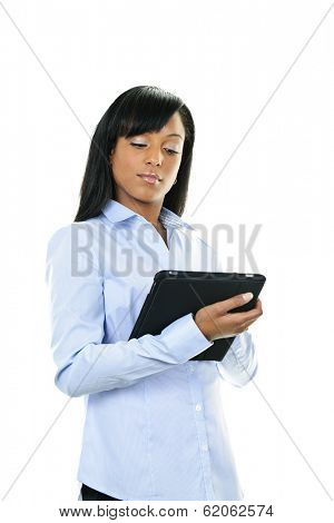 Young serious black woman working with tablet computer