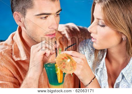 Young Couple Drinking Cocktail