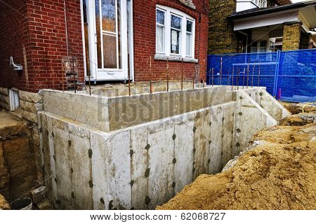 Building addition to residential house with new foundation