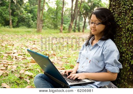 Female College Student Working On A Laptop