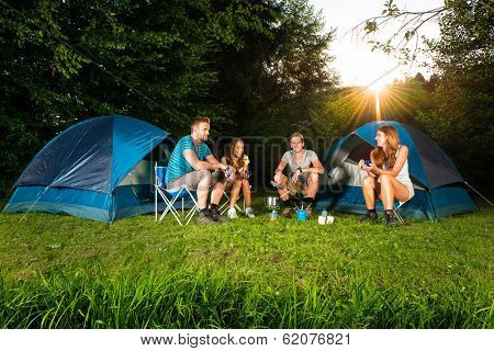 cooking on a camping with a group of young friends