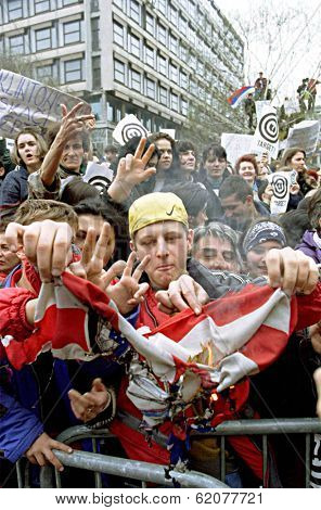 BELGRADE, SERBIA, 30 MARCH 1999 -- Serbs burn an American flag during a mass anti-NATO protest held  today in the capital Belgrade. Thousands turned out to hear speeches condemning NATO airstrikes.