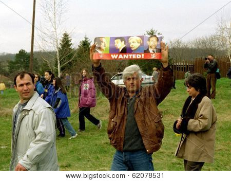BELGRADE, YUGOSLAVIA - 29 MARCH: Yugoslavian citizens march through the streets of the capital Belgrade today in protest against NATO airstrikes on March 29, 1999.  NATO air-strikes have entered their fifth day.