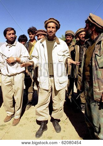 MAZAR, AFGHANISTAN - OCTOBER 3: Anti-Taliban forces co-leader Ahmed Shah Massood, seen here at center, gives directions to his troops during a battle for a mountain pass south of Mazar on Oct 3, 1996 in Mazar, Afghanistan.