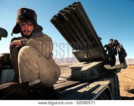CHARIKAR, AFGHANISTAN - OCTOBER 17: A soldier loyal to northern Afghani warlord General Rashid Dostum sits atop  a mobile rocket launcher just north of Kabul on Oct 17, 1996 in Charikar, Afghanistan.