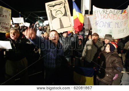 BUCHAREST, ROMANIA - JAN 17: Thousands of demonstrators protest against a series of unpopular austerity measures enacted by the Romanian government in Bucharest, Romania, on Tuesday, January 17, 2012.