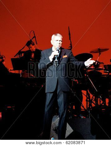 WASHINGTON, D.C. - JULY 21: Frank Sinatra sings to a sellout crowd at the Warner Theater in Washington, D.C. Backing Sinatra was the Nelson Riddle Orchestra on July 21, 1991 in Washington DC