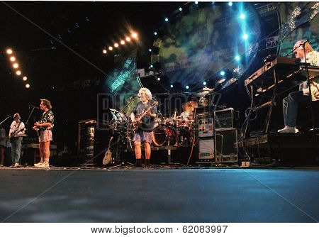 EAST RUTHERFORD, NEW JERSEY - AUGUST 3: The Grateful Dead in concert in East Rutherford, New Jersey, on Sunday, August 3, 1994.  From left is Phil Lesh, Bob Wier, Jerry Garcia, Micky Hart, and Vince Welnick