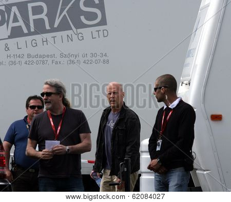 BUDAPEST - MAY 8: Actor Bruce Willis arrives on the set of Die Hard 5: A Good Day To Die Hard in Budapest, Hungary. on Tuesday, May 8, 2012.