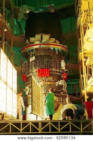 BAIKONUR COSMODROME, - OCTOBER 30: Russian space engineers piece together a Progress M1 spacecraft in the RSC Energia assembly building at the Cosmodrome in Baikonur, Kazakhstan, on October 30, 2000.