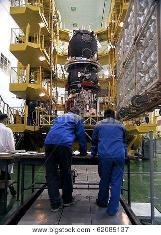 BAIKONUR COSMODROME - OCTOBER 30: Russian engineers go over blueprints for the Progress M1 spacecraft in the RSC Energia vehicle assembly building at the Baikonur Cosmodrome in Baikonur, Kazakhstan.